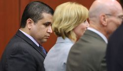 ** FILE ** George Zimmerman looks down as he stands next to defense co-counsels (from second from left) Lorna Truett, Don West and Mark O'Mara as Mr. Zimmerman is found not guilty in the Seminole Circuit Court in Sanford, Fla., on Saturday, July 13, 2013. Mr. Zimmerman was cleared of all charges in the shooting death of Trayvon Martin, the unarmed black teenager whose killing unleashed a furious debate across the U.S. over racial profiling, self-defense and equal justice. (AP Photo/Orlando Sentinel, Joe Burbank, Pool)