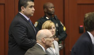 George Zimmerman stands with his defense attorneys during the continuation of jury deliberations in his trial in Seminole Circuit Court in Sanford, Fla., on Saturday, July 13, 2013. Mr. Zimmerman later was acquitted of all charges in the 2012 shooting death of Trayvon Martin. (Gary W. Green/Orlando Sentinel)