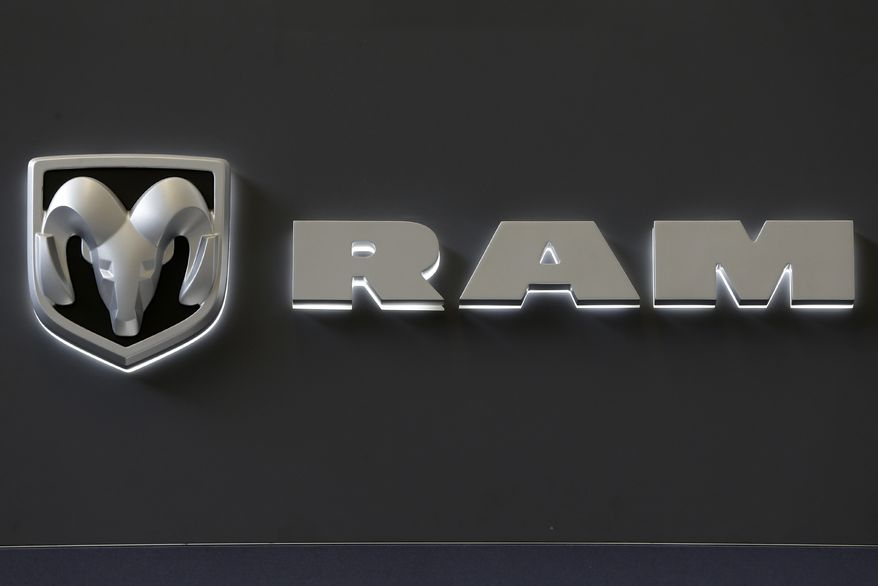 The Dodge Ram truck logo appears on a sign at the Pittsburgh Auto Show in Pittsburgh on Feb. 14, 2013. Sales from the major automakers showed that confident U.S. buyers snapped up new cars and trucks at a strong pace in June. (AP Photo/Gene J. Puskar)