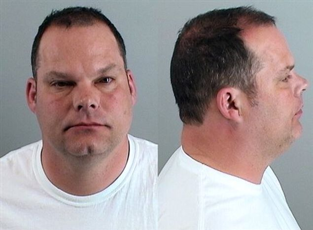 **FILE** In a photo provided by the Douglas County (Colo.) Sheriff's Department, Tom Heckert, the Denver Broncos' new director of pro personnel, appears in a photo after he was arrested on June 11, 2013, and charged with driving under the influence and careless driving. Another Broncos executive, Matt Russell, was arrested over the weekend on suspicion of driving under the influence. (AP Photo/Douglas County Sheriff's Department)