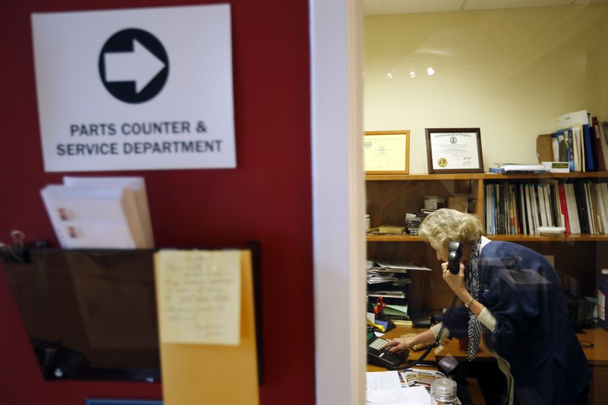 June Springer, an office receptionist who just turned 90, answers a phone at Caffi Contracting Services in Alexandria, Va., on Friday, July 12, 2013. (AP Photo/Alex Brandon)