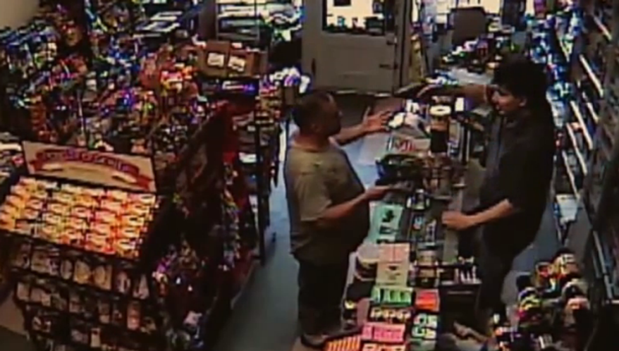 Police say a Pennsylvania store clerk with a real gun thwarted an attempted robbery by a suspect armed only with a BB-gun on July 15, 2013. The store's surveillance camera caught the entire event Saturday and the suspect was in custody a short time later. (Screen shot from Associated Press video)