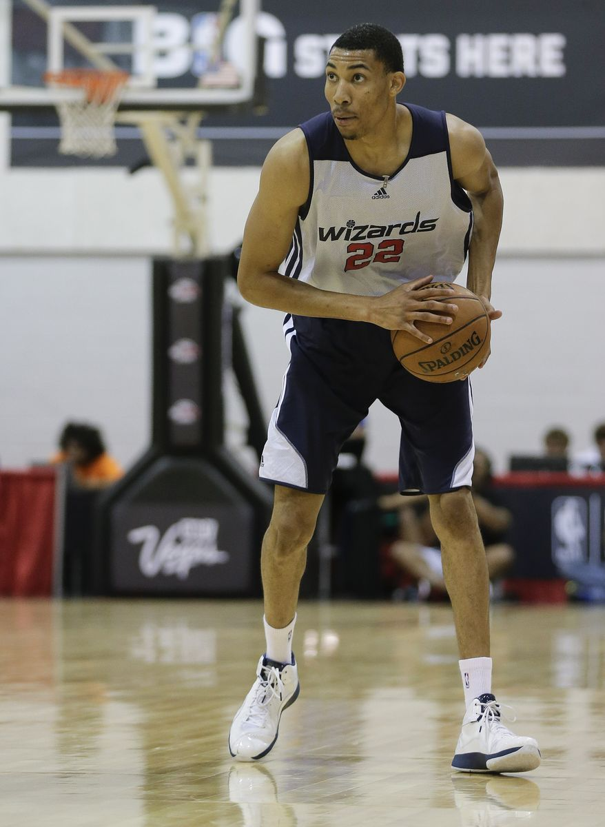 Washington Wizards Otto Porter looks to pass against the Golden State Warriors in the second quarter of an NBA Summer League basketball game, Saturday, July 13, 2013, in Las Vegas. (AP Photo/Julie Jacobson)