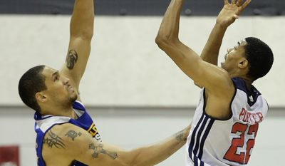 Washington Wizards Otto Porter, right, loses control of the ball while shooting against Golden State Warriors Dwayne Jones, left, in the third quarter of an NBA Summer League basketball game, Saturday, July 13, 2013, in Las Vegas. (AP Photo/Julie Jacobson)