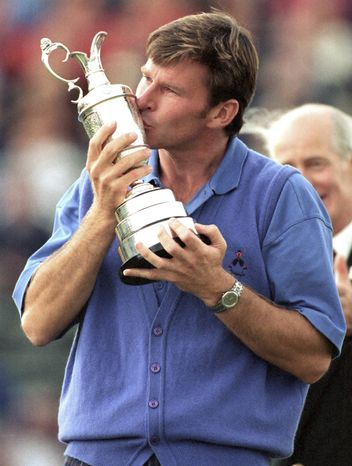 **FILE** Britain's Nick Faldo kisses the British Open golf championship trophy he won at Muirfield in Scotland, July 19, 1992. (AP Photo/Denis Paquin)