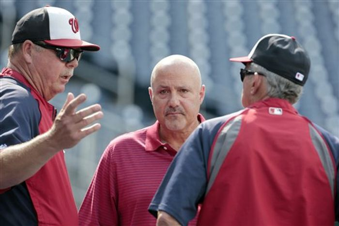 **FILE** Washington Nationals pitching coach Steve McCatty, left, talks with general manager Mike Rizzo, and manager Davey Johnson during batting practice before a baseball game against the Milwaukee Brewers at Nationals Park Monday, July 1, 2013, in Washingto