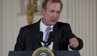 Neil Bush speaks during a ceremony to award the 5,000th Daily Point of Light Award to Floyd Hammer and Kathy Hamilton, from Union, Iowa, in the East Room of the White House in Washington, Monday, July 15, 2013. (AP Photo/Carolyn Kaster)