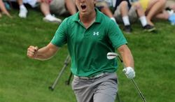 PGA Tour pro Jordan Spieth reacts to chipping in from the bunker for a birdie on the 18th hole during the final round of the John Deere Classic golf tournament in Silvis, Ill., Sunday, July 14, 2013. Spieth won the tournament on the 5th playoff hole. (AP Photo/The Dispatch, Todd Mizener)