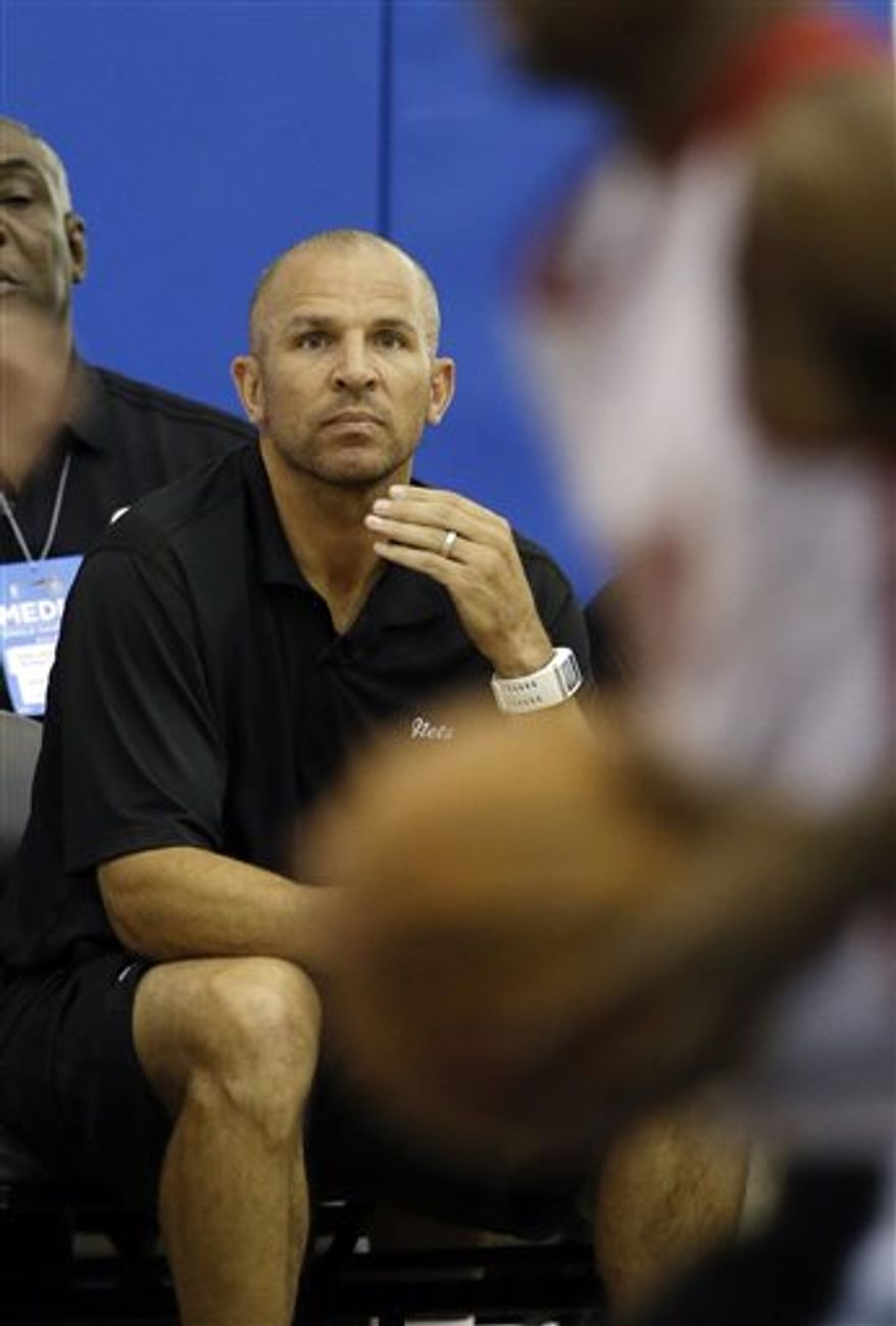 FILE - Brooklyn Nets head coach Jason Kidd watches his team play against the Miami Heat during an NBA summer league basketball game, in this July 8, 2013 file photo taken in Orlando, Fla. (AP Photo/John Raoux, File)
