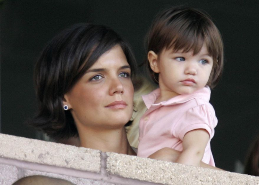 ** FILE ** Katie Holmes and her daughter, Suri Cruise watch the Los Angeles Galaxy play Chelsea during a World Series of Football exhibition soccer game at the Home Depot Center on Saturday, July 21, 2007, in Carson, Calif. (AP Photo/Mark J. Terrill)