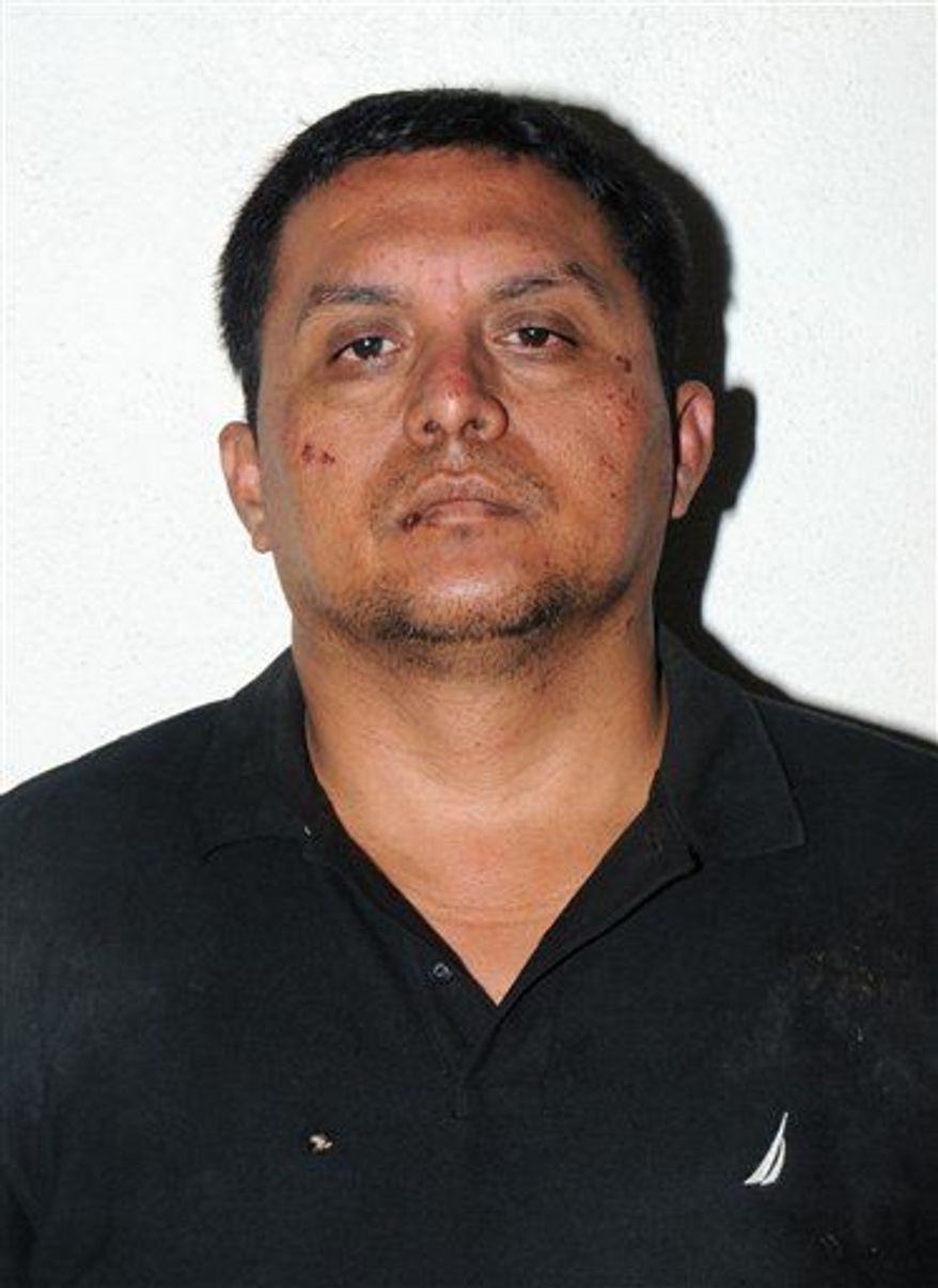 Zetas drug cartel leader Miguel Angel Trevino Morales is shown in the Tuesday, July 16, 2013 photo after his arrest in Mexico. Trevino Morales, 40, was captured before dawn Monday by Mexican marines who intercepted a pickup truck with $2 million in cash in the countryside outside the border city of Nuevo Laredo, which has long served as the Zetas' base of operations. (AP Photo/Mexican Navy)