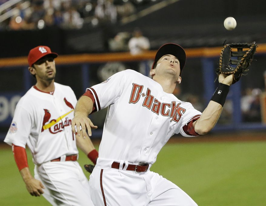 National League's Paul Goldschmidt, right, of the Arizona Diamondbacks, catches a foul ball hit by American League's Miguel Cabrera, of the Detroit Tigers, ?during the sixth inning of the MLB All-Star baseball game, on Tuesday, July 16, 2013, in New York. (AP Photo/Matt Slocum)