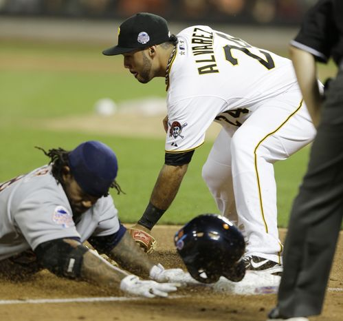 American League's Prince Fielder, of the Detroit Tigers, is safe at third as National League's Pedro Alvarez, of the Pittsburgh Pirates, attempts to make the tag on a triple by Fielder during the ninth inning of the MLB All-Star baseball game, on Tuesday, July 16, 2013, in New York. (AP Photo/Kathy Willens)