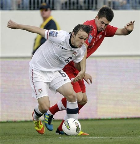 **FILE** Jared Jeffrey (6), of the United States, dribbles as he is defended by Philippe Davies, right, of Canada, in the first half of a CONCACAF Olympic qualifying soccer match on Saturday, March 24, 2012, in Nashville, Tenn. (AP Photo/Mark Humphrey)