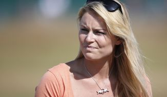 ** FILE ** Skier Lindsey Vonn watches her boyfriend Tiger Woods of the United States during a practice round ahead of the British Open Golf Championship at Muirfield, Scotland, Wednesday July 17, 2013. (AP Photo/Peter Morrison)