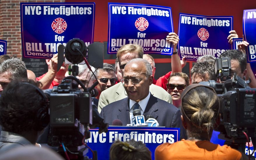 William C. Thompson (center), a Democratic candidate for New York mayor, speaks after receiving the firefighters union's endorsement on Tuesday, July 9, 2013, in New York. (AP Photo/Bebeto Matthews)