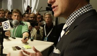 Texas A&M quarterback Johnny Manziel talks with reporters during the Southeastern Conference football Media Days in Hoover, Ala., Wednesday, July 17, 2013. (AP Photo/Dave Martin)
