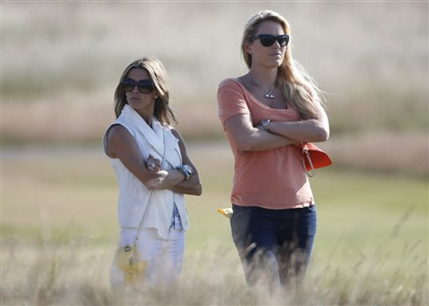Lindsey Vonn, right, girlfriend of Tiger Woods of the United States, and Nadine Moze, girlfriend of Fred Couples of the United States watch a practice round ahead of the British Open Golf Championship at Muirfield, Scotland, Wednesday July 17, 2013. (AP Photo/Peter Morrison)