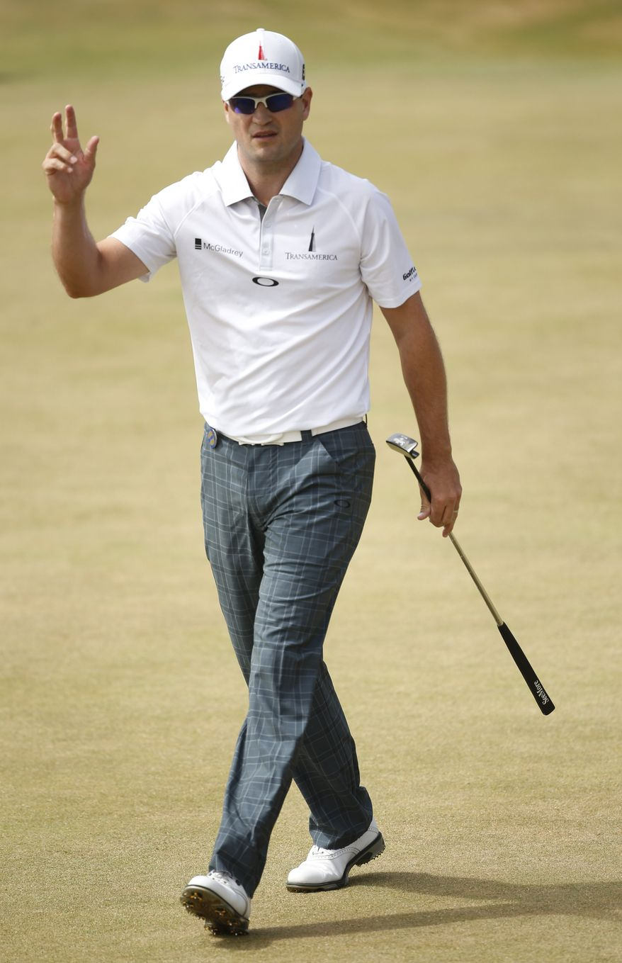 Zach Johnson of the United States reacts after putting on the 10th green during the first round of the British Open Golf Championship at Muirfield, Scotland, Thursday July 18, 2013. (AP Photo/Peter Morrison)