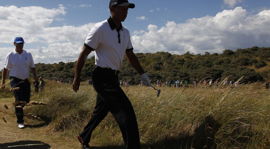 Phil Mickelson of the United States prepares to play off the 6th tee with his caddie Jim Mackay during the first round of the British Open Golf Championship at Muirfield, Scotland, Thursday July 18, 2013. (AP Photo/Scott Heppell)