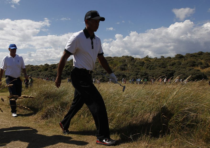 Tiger Woods of the United States lines up a putt on the second green during the first round of the British Open Golf Championship at Muirfield, Scotland, Thursday July 18, 2013. (AP Photo/Jon Super)