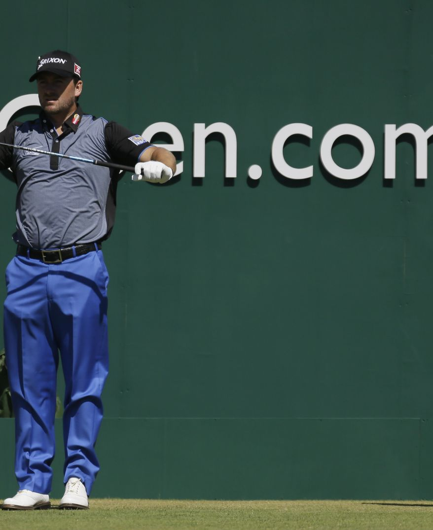 Bubba Watson of the United States holds his ball after putting on the 9th green during the first round of the British Open Golf Championship at Muirfield, Scotland, Thursday July 18, 2013. (AP Photo/Jon Super)
