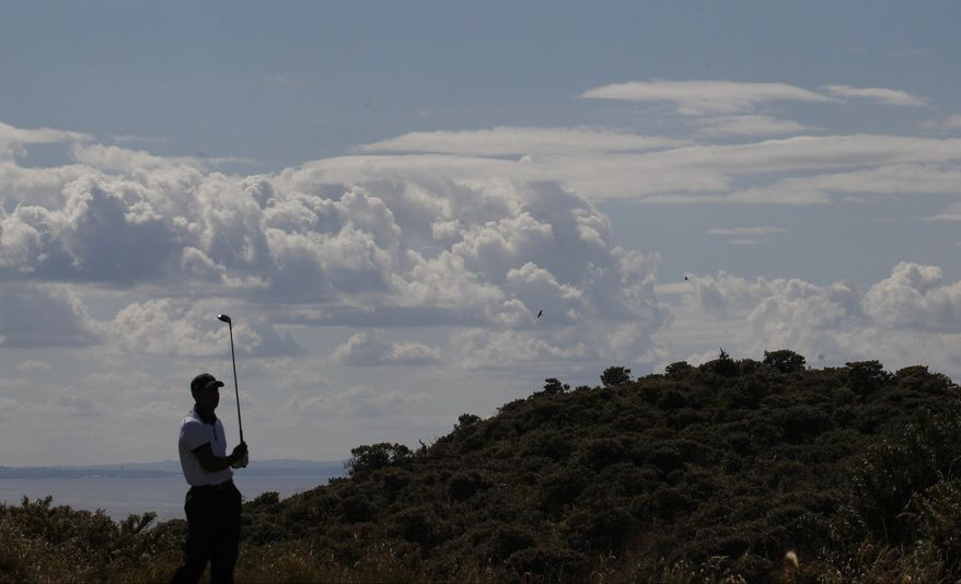 Tiger Woods of the United States prepares to play off the 5th tee during the first round of the British Open Golf Championship at Muirfield, Scotland, Thursday July 18, 2013. (AP Photo/Jon Super)