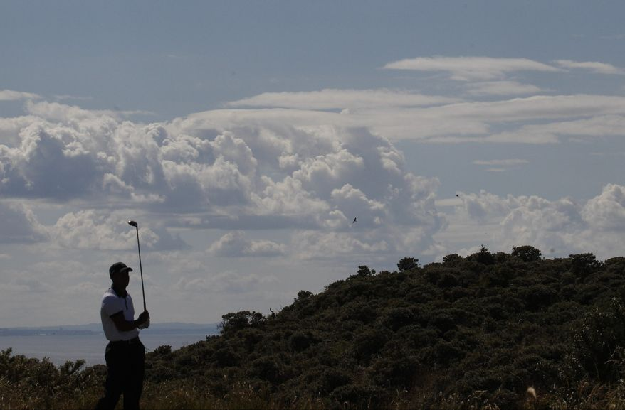 Rory McIlroy of Northern Ireland looks down the first fairway during the first round of the British Open Golf Championship at Muirfield, Scotland, Thursday July 18, 2013. (AP Photo/Peter Morrison)