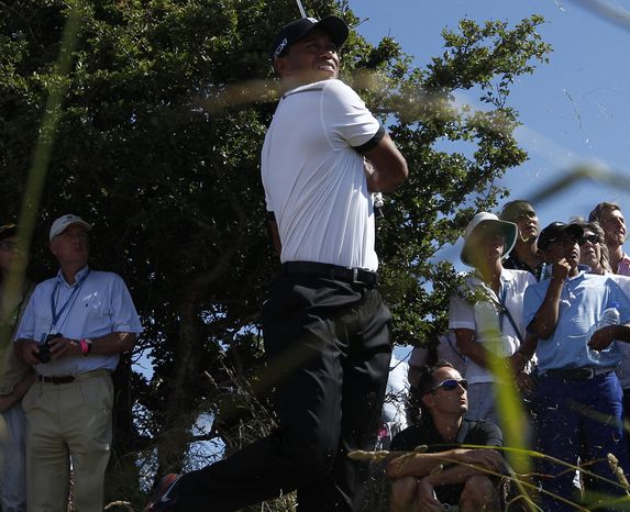 Phil Mickelson of the United States plays a shot off the third tee during the first round of the British Open Golf Championship at Muirfield, Scotland, Thursday July 18, 2013. (AP Photo/Peter Morrison)