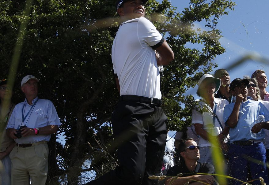 Tiger Woods of the United States walks along the third hole during the first round of the British Open Golf Championship at Muirfield, Scotland, Thursday July 18, 2013. (AP Photo/Jon Super)
