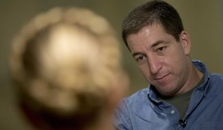 ** FILE ** Journalist Glenn Greenwald speaks during an interview with The Associated Press in Rio de Janeiro, Brazil, Sunday, July 14, 2013. (AP Photo/Silvia Izquierdo)