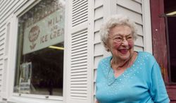 Margaretta Wolf, 96, stands in front of Wolf's Groceries in Marshfield, Tuesday, July 16, 2013, the day after an attempted robbery at knifepoint happened at her store. The masked man ordered Wolf to open the cash register. She told him he could have all the Tootsie Rolls he wanted, but she wasn't going to open the register, and stood her ground when the would-be robber flashed his knife. (AP Photo/News-Herald, Megan Mccormick)