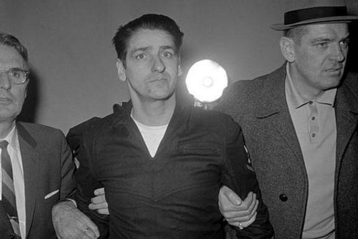 ** FILE ** Albert DeSalvo, who says he strangled 13 women in the Boston area, is pictured minutes after his capture in Lynn, Mass., Feb. 25, 1967, north of Boston. (Associated Press)