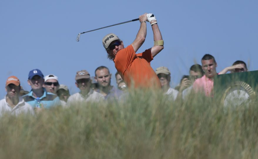 Miguel Angel Jimenez of Spain plays a shot from the 15th tee during the second round of the British Open Golf Championship at Muirfield, Scotland, Friday July 19, 2013. (AP Photo/Jon Super)