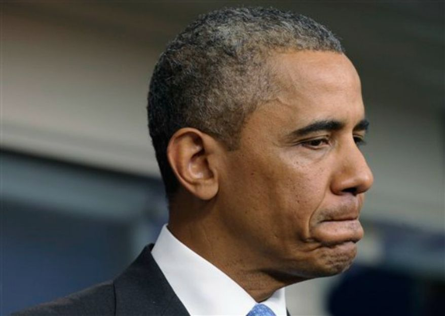 """President Oama pauses as he speaks to reporters in the Brady Press Briefing room of the White House in Washington, Friday, July 19, 2013. Obama says black Americans feel pain after the Trayvon Martin verdict because of a """"history that doesn't go away."""" (Associated Press)"""