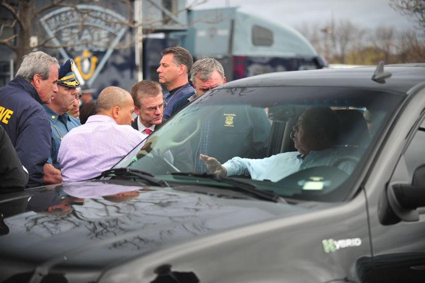 FBI and police officials brief Massachusetts Gov. Deval Patrick and Boston Mayor Tom Menino. (Sgt: Sean Murphy)