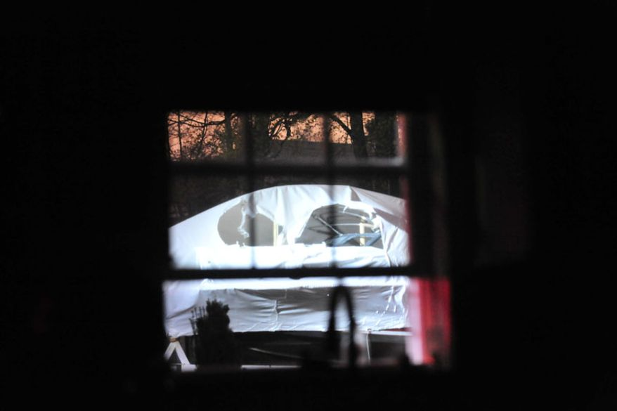 A sniper's view of the boat where Dzhokhar Tsarnaev is hiding. (credit: Sgt. Sean Murphy)