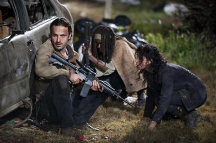 """Andrew Lincoln as Rick Grimes, Danai Gurira as Michonne and Melissa Ponzio as Karen, in a scene from Episode 16, """"Welcome to the Tombs"""" from Season 3 of """"The Walking Dead."""" (AP Photo/AMC, Gene Page)"""
