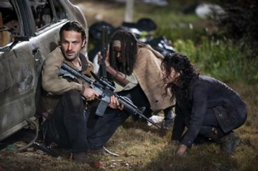 "Andrew Lincoln as Rick Grimes, Danai Gurira as Michonne and Melissa Ponzio as Karen, in a scene from Episode 16, ""Welcome to the Tombs"" from Season 3 of ""The Walking Dead."" (AP Photo/AMC, Gene Page)"