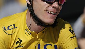 Christopher Froome of Britain, wearing the overall leader's yellow jersey, flashes a thumbs up and a big smile as crosses the finish of the 20th stage of the Tour de France cycling race over 125 kilometers (78.1 miles) with start in in Annecy and finish in Annecy-Semnoz, France, Saturday July 20 2013. (AP Photo/Laurent Rebours)