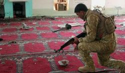 An Iraqi army soldier inspects the damage inside the Abu Bakr Mosque in Baqouba, northeast of Baghdad, Iraq, Friday, July 19, 2013. A bomb hidden in an air conditioner that ripped through a Sunni mosque during midday prayers and other attacks killed dozens in Iraq on Friday, extending a wave of violence targeting worshippers during the holy month of Ramadan. (Associated Press)
