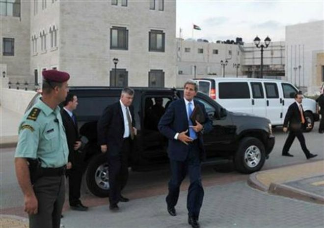U.S. Secretary of State John Kerry steps out of a vehicle as he prepares to depart from a meeting with Palestinian President Mahmoud Abbas on Friday, July 19, 2013 in the West Bank city of Ramallah. (AP Photo/Mandel Ngan, Pool)