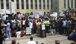 """Radio talk show host Joe Madison addresses a """"Justice for Trayvon"""" rally outside the U.S. District Court for the District on Saturday (Andrea Noble/The Washington Times)"""