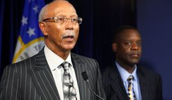"Detroit Mayor Dave Bing (left), with state-appointed emergency manager Kevyn Orr, said Sunday, ""There are over 100 major urban cities that are having the same problems we're having. We may be one of the first. We are the largest, but we absolutely will not be the last."" (Associated Press)"