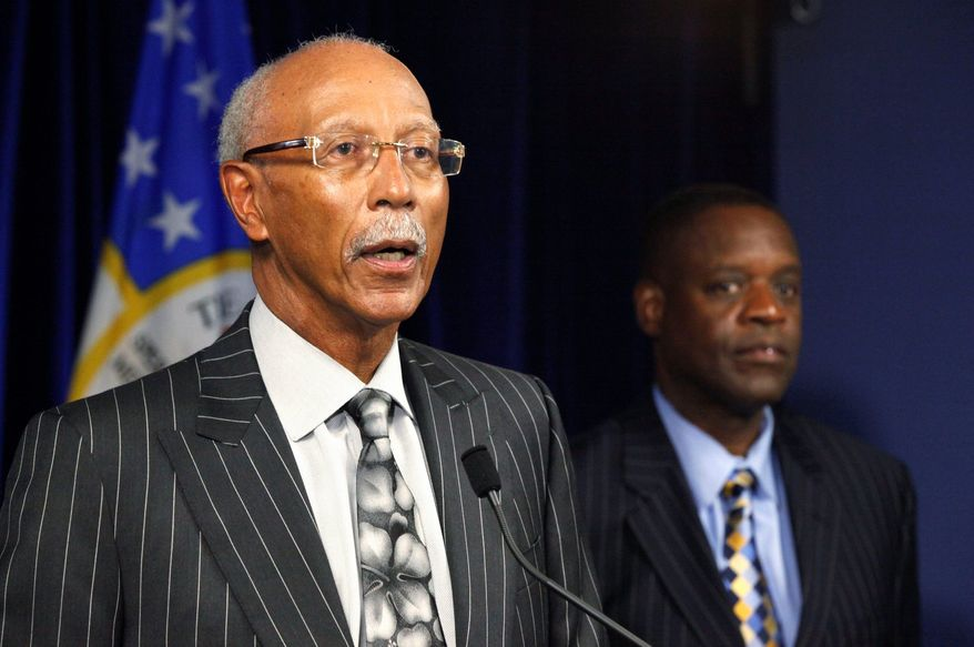 """Detroit Mayor Dave Bing (left), with state-appointed emergency manager Kevyn Orr, said Sunday, """"There are over 100 major urban cities that are having the same problems we're having. We may be one of the first. We are the largest, but we absolutely will not be the last."""" (Associated Press)"""