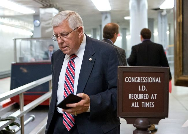 Sen. Mike Enzi, R-Wyo., walks to the floor of the Senate for a vote, Thursday, July 18, 2013, at the Capitol in Washington. Liz Cheney, elder daughter of former Vice President Dick Cheney, announced this week that she will run against Enzi, a three-term incumbent and fellow Republican. (AP Photo/J. Scott Applewhite)