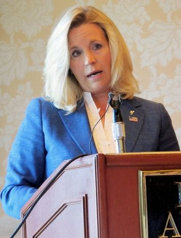 ** FILE ** Liz Cheney, who espouses the neoconservative views of her father, former Vice President Dick Cheney, is challenging Sen. Michael B. Enzi, who has been sw