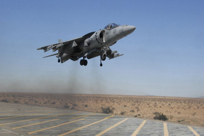** FILE ** An AV-8B Harrier jet, piloted by U.S. Marine Capt. Andrew D'Ambrogi of Marine Attack Squadron 211, comes in for a landing at Auxiliary Airfield II, a simulated amphibious assault ship flight deck, on the Barry M. Goldwater Range in Yuma, Ariz., on Sept. 12, 2008. (AP Photo/U.S. Marine Corps, Cpl. T.M. Stewman)
