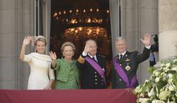 Belgium's King Philippe (from right); his father, King Albert II; his mother, Queen Paola; and his wife, Queen Mathilde, wave to the crowd from the balcony of the Royal Palace in Brussels on Sunday, July 21, 2013. Philippe took the oath of office to became the seventh king of the Belgians after his 79-year-old father abdicated as the head of the fractured nation. (AP Photo/Geert Vanden Wijngaert)