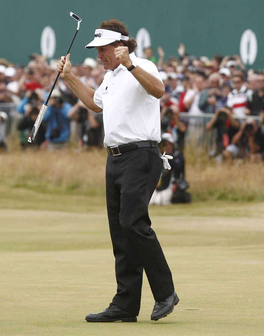 Phil Mickelson of the United States celebrates after his final putt on the 18th green during the final round of the British Open Golf Championship at Muirfield, Scotland, on Sunday July 21, 2013. (AP Photo/Jon Super)